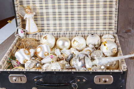 antique suitcase: Ancient old white Christmas tree toys in antique suitcase