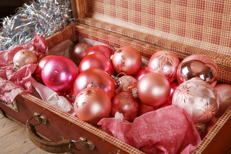 antique suitcase: Ancient old pink Christmas tree toys in antique suitcase