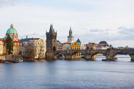 View of the Vltava River and the bridges on cold rainy spring or autumn day, Prague, the Czech Republic photo