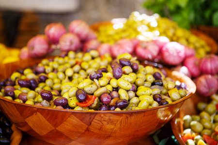 street market: Marinated garlic and olives on provencal street market in Provence, France. Selling and buying. Stock Photo