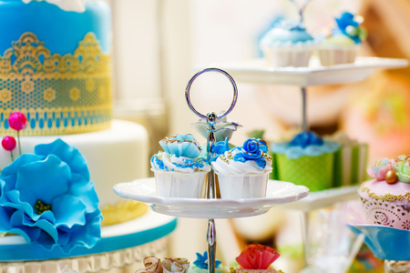 Elegant sweet table with cupcakes and other sweets for dinner or event party