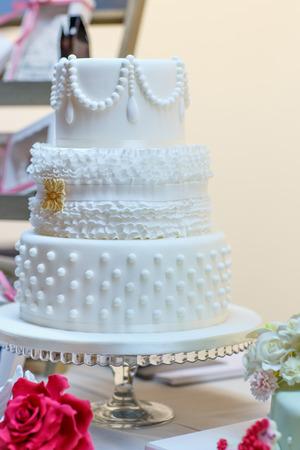 tiered: Wedding cake in white. Elegant and romantic big cake.
