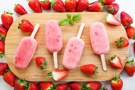 Homemade ice cream pops with fresh berries