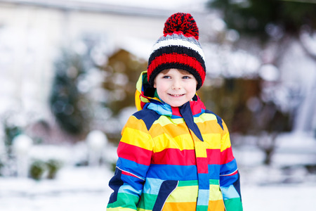 outoors: Portrait of little boy in colorful clothes in winter, outdoors  on cold day. Active outoors leisure with children in winter. Stock Photo