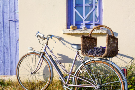 Farmer house near lavender fields near Valensole in Provence, France. With bike, lavender bouquet in basket with typical provencal style. Stock Photo