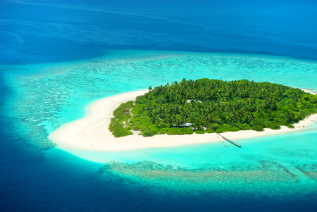 Beautiful tropical island from above. Maldives, Carribean or South see resort.