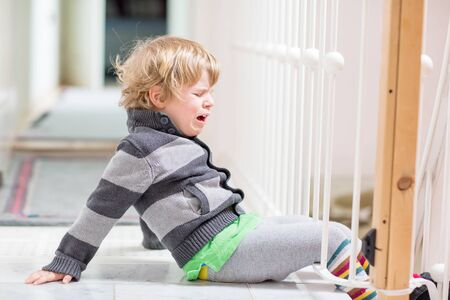 crying kid: Little kid boy crying at home and showing sad mood, indoors.