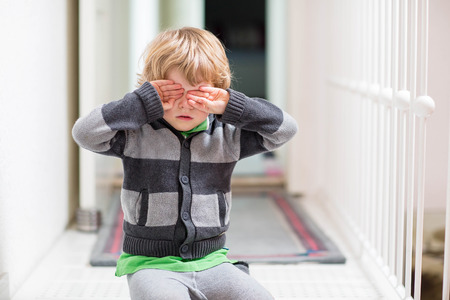 cute little boy: Little kid boy crying at home and showing sad mood, indoors.
