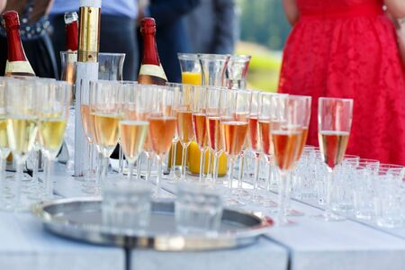 skoal: Glasses with champagne, orange juice and wine on summer wedding. Selective focus Stock Photo