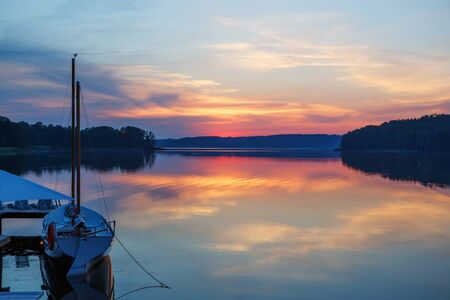 masuria: Beautiful view of the lake in Masuria District, Poland on sunset. Fantastic travel destination. Stock Photo