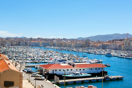 major ocean: Aerial panoramic view on old port in Marseille, France. On sunny warm day in Provence.