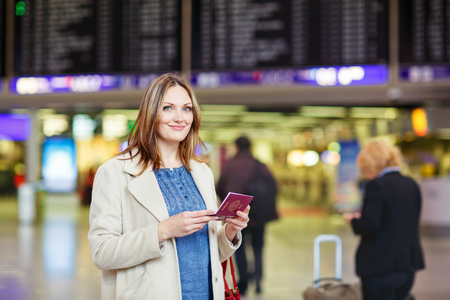 tired woman: Tired woman at international airport walking through terminal. Upset business passenger waiting. Canceled flight due to pilot strike. Stock Photo
