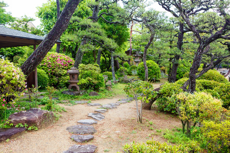 japan: Pleasant and beautiful Japanese style garden in Japan. On summer day Stock Photo