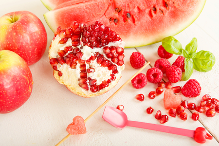 healthy snack: Fresh organic fruits and berrys: rapsberry, watermelon, pomegranate as healthy snack. Vegan and vegetarian food. Stock Photo