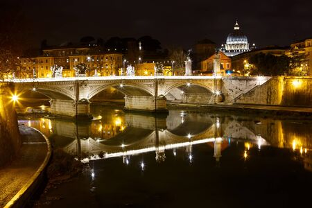 san: View at Tiber and St. Peters cathedral in Rome, Italy by night. With lights.