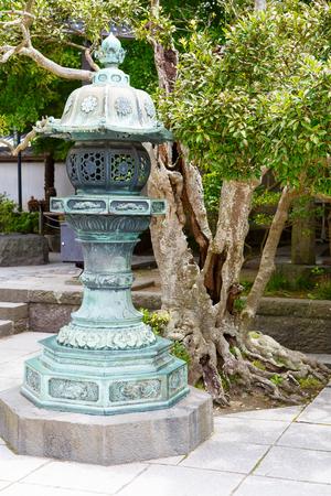 kanagawa: Part of Kotokuin Temple, Kanagawa, Kamakura in Japan. Holy lantern as symbol of buddhism Stock Photo