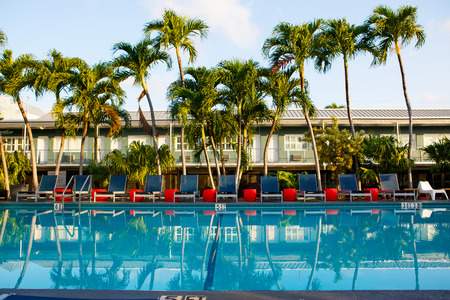 key of paradise: beautiful swimming pool in tropical resort. With palms on background. Stock Photo