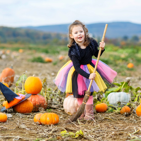 Cute little girl of 3 years wearing halloween witch costume having fun on a pumpkin patch  sc 1 st  123RF.com & Cute Little Girl Of 3 Years Wearing Halloween Witch Costume Having ...