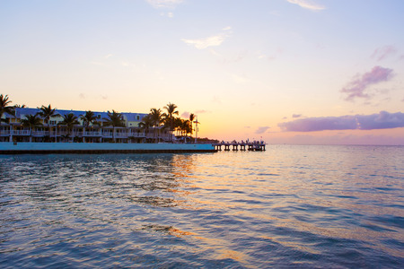 nightfall: Beautiful sunrise on Key West, Florida, USA. With palms and resorts on background Stock Photo