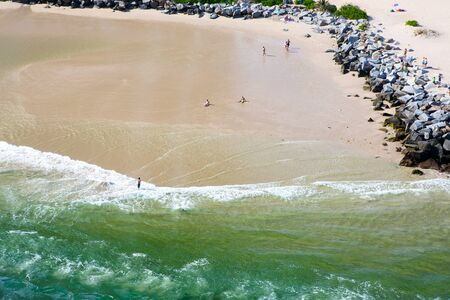 surfers: Aerial view of Miami South Beach, Florida, USA. With surfers and peple taking bath and swimming.