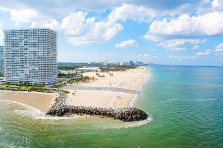 oceanfront: Aerial view of Miami South Beach, Florida, USA. With surfers and peple taking bath and swimming.