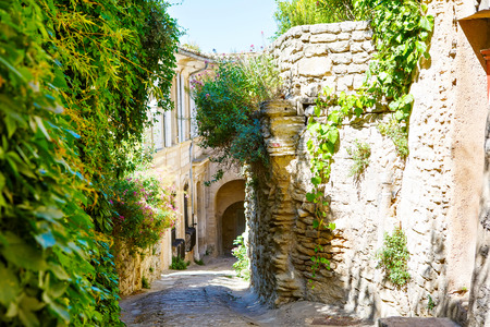 Old street of Gordes, a small typical town in Provence, France. Beautiful village, with view on roof and landscape