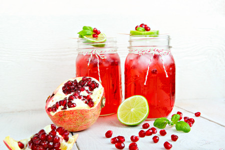 non alcoholic beverage: Two glasses with red pomgranate juice, lemon and mint. Healthy vegan and detox drink. Refreshment and against flu