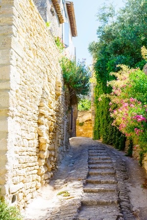 gordes: Old street of Gordes, a small typical town in Provence, France. Beautiful village, with view on roof and landscape