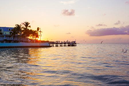 Beautiful sunrise on Key West, Florida, USA. With palms and resorts on background Stock Photo
