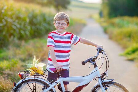 shool: Shool kid boy having fun with riding of bicycle Stock Photo