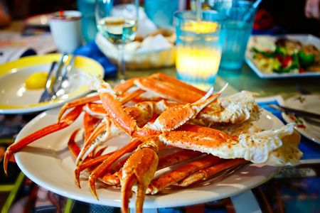 Plate with crab legs in a restaurant in Key West or New Orleans 스톡 콘텐츠