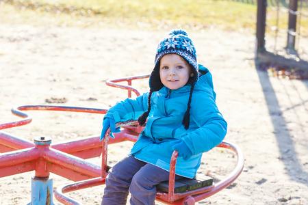 Little toddler boy having fun on playground