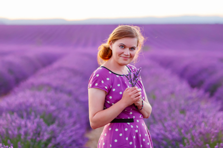 Romantic woman in lavender fields, having vacations in Provence, Stock Photo