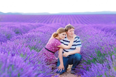 Romantic couple in love in lavender fields Provence, France.