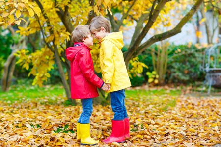kiddies: Two little best friends and kids boys autumn park in colorful clothes. Stock Photo
