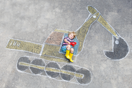 Funny little kid boy with excavator chalk picture Stock Photo