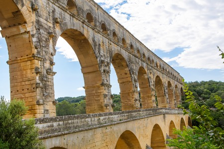 Pont du Gard is an old Roman aqueduct near Nimes in Southern France. Travel destination for tourists in Provence. Stock Photo - 81942981