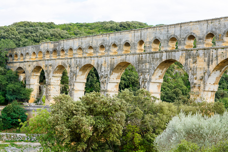 Pont du Gard is an old Roman aqueduct near Nimes in Southern France. Travel destination for tourists in Provence. Stock Photo - 81942982