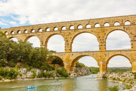 Pont du Gard is an old Roman aqueduct near Nimes in Southern France. Travel destination for tourists in Provence.