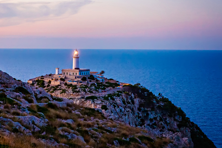 Lighthouse at Cape Formentor in the Coast of North Mallorca, Spain ( Balearic Islands ). Artistic sunrise and dusk landascape