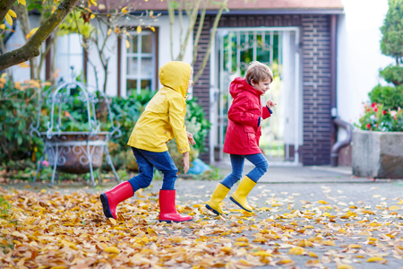 Two little best friends and kids boys autumn park in colorful cl Stock Photo