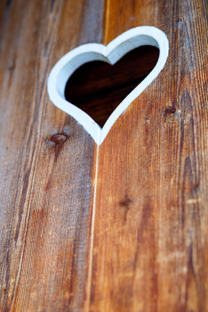 Wooden fence with heart. Part of a window in Tirol, Austria Stock Photo