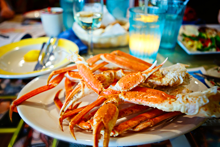 Crab legs with butter. Delicious meal in Florida, Key West or Miami Stock Photo
