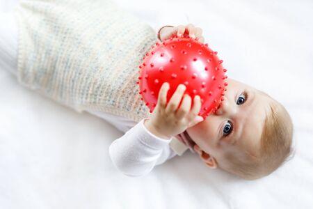eye ball: Cute baby playing with red gum ball, crawling, grabbing
