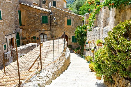Beautiful street in Valldemossa with traditional flower decoration, famous old mediterranean village of Majorca. Balearic island Mallorca, Spain 写真素材