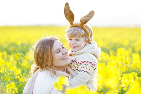 Little toddler child and his mother in Easter bunny ears having