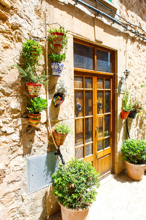 Beautiful street in Valldemossa with traditional flower decoration, famous old mediterranean village of Majorca. Balearic island Mallorca, Spain Imagens