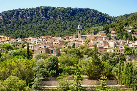 View on city Valldemossa with traditional flower decoration, famous old mediterranean village of Majorca. Balearic island Mallorca, Spain