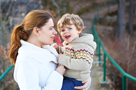 Mother and little son in park or forest, outdoors. Stock Photo
