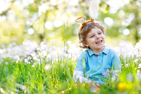 Little kid boy with Easter bunny ears, outdoors